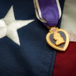 The Purple Heart is a United States military decoration awarded in the name of the President to those wounded or killed while serving and the american flag (Getty Images)