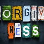 Forgiveness word on vintage broken car license plates, concept sign (Getty Images)